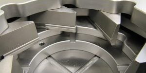 Special jaws to hold tapered part against a stop in a stainless steel six jaw chuck